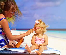mother applying sunblock daughter
